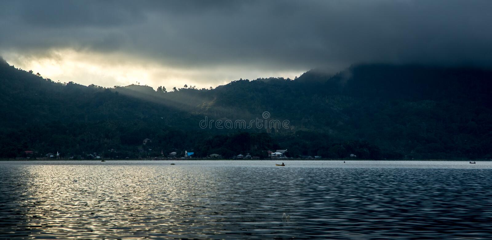 Waterfront, Manado, Indonesia. Coastline of waterfront in Manado, Indonesia on stormy day royalty free stock photo