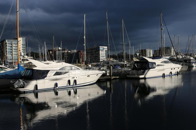 Ipswich waterfront marina with storm clouds. Waterfront marina and surrounding buildings in Ipswich, Suffolk, United Kingdom with very dark storm clouds and stock image