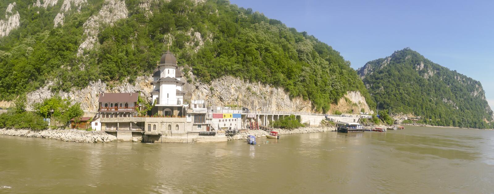 Waterfront Mraconia Monastery  in Iron Gate. Waterfront Mraconia Monastery  on shores in the Iron Gate gorges on the Danube River between Serbia and Romania royalty free stock images