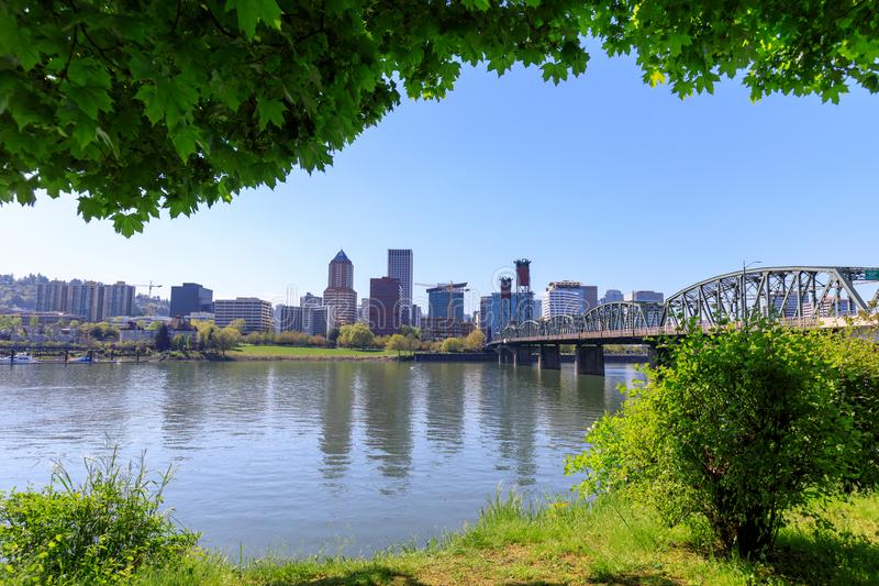Waterfront Park with Hawthorne Bridge on the Willamette River in downtown Portland, Oregon. Portland, Oregon, USA - April 27, 2018 : Waterfront Park with royalty free stock photo