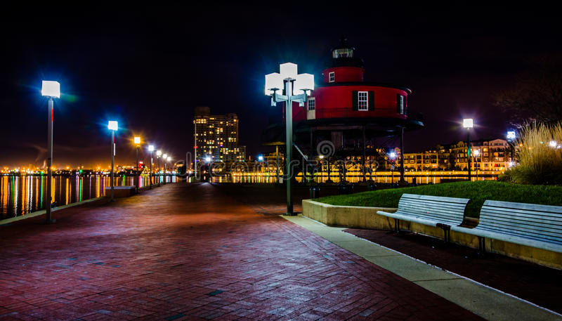 Waterfront promenade and lighthouse at night in the Inner Harbor royalty free stock photos