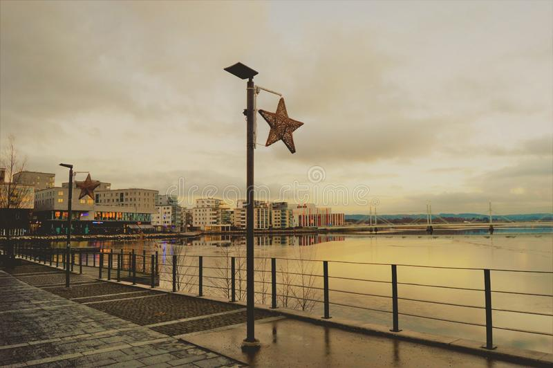 Waterfront promenade on overcast day stock photos