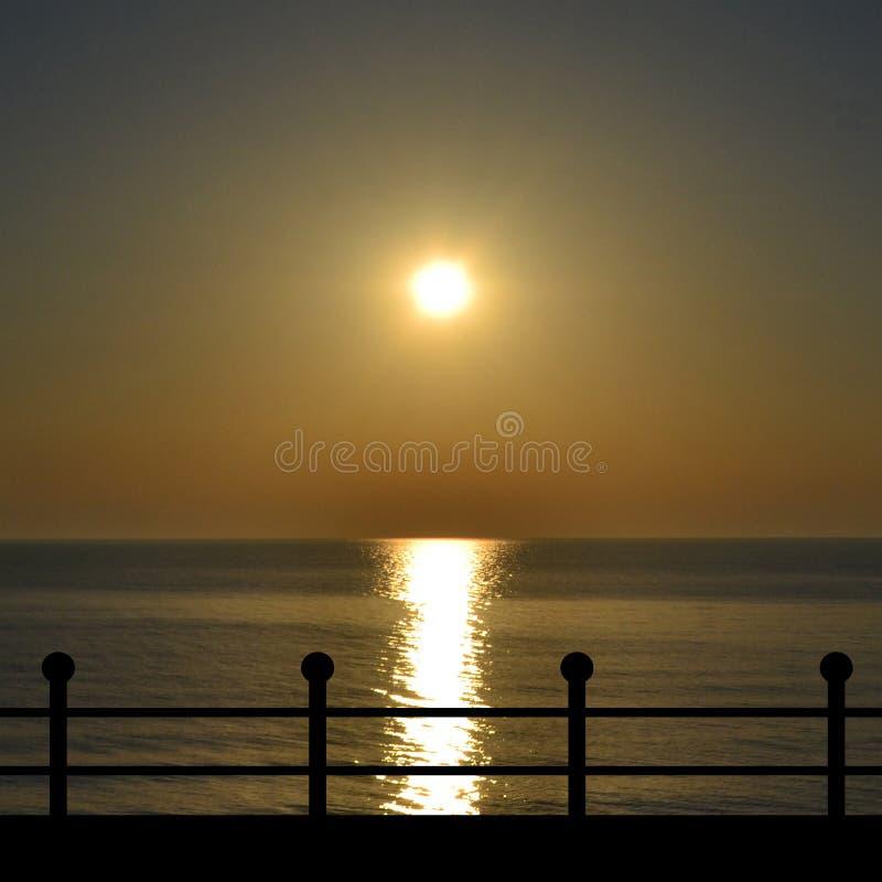 Waterfront promenade at sunset stock photos