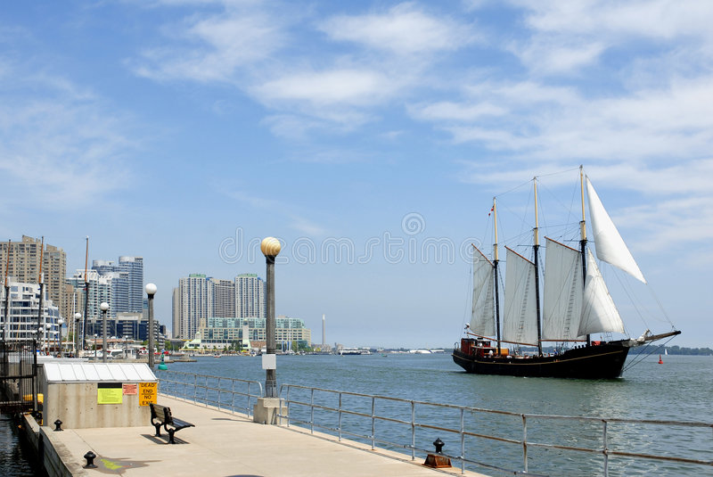 Waterfront with sailboat royalty free stock images