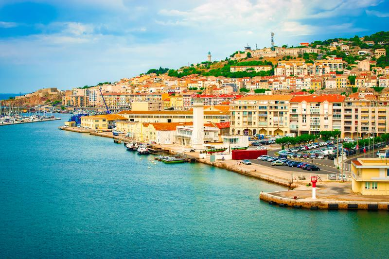 Port of Sete, France. Waterfront of Sete in France. Cruise port and harbor with many buildings on the hill. Colorful bright image royalty free stock photography