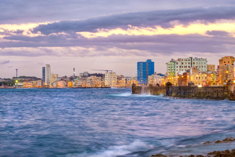 The waterfront skyline of Havana at sunset. With a view of the Caribbean sea and the malecon seawall royalty free stock photos