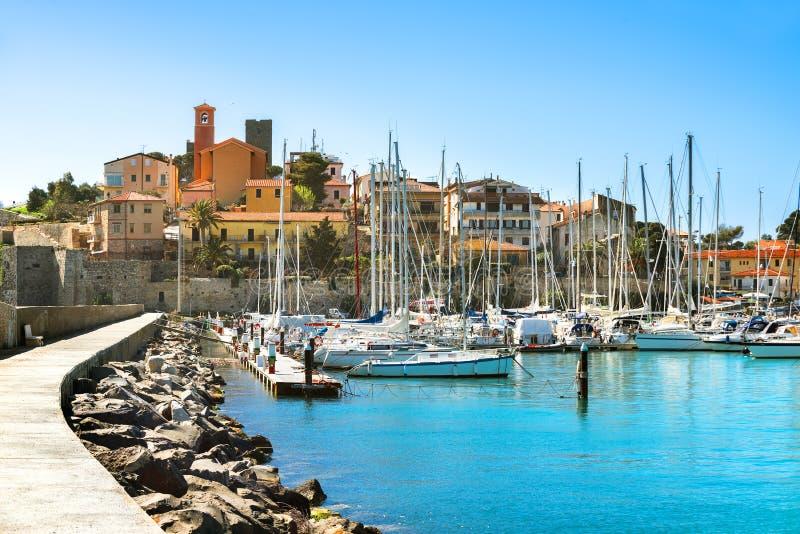 Waterfront of small town of Talamone. Grosseto region, Tuscany,. View of coastal town of Talamone. Grosseto region, Tuscany, Italy stock photo