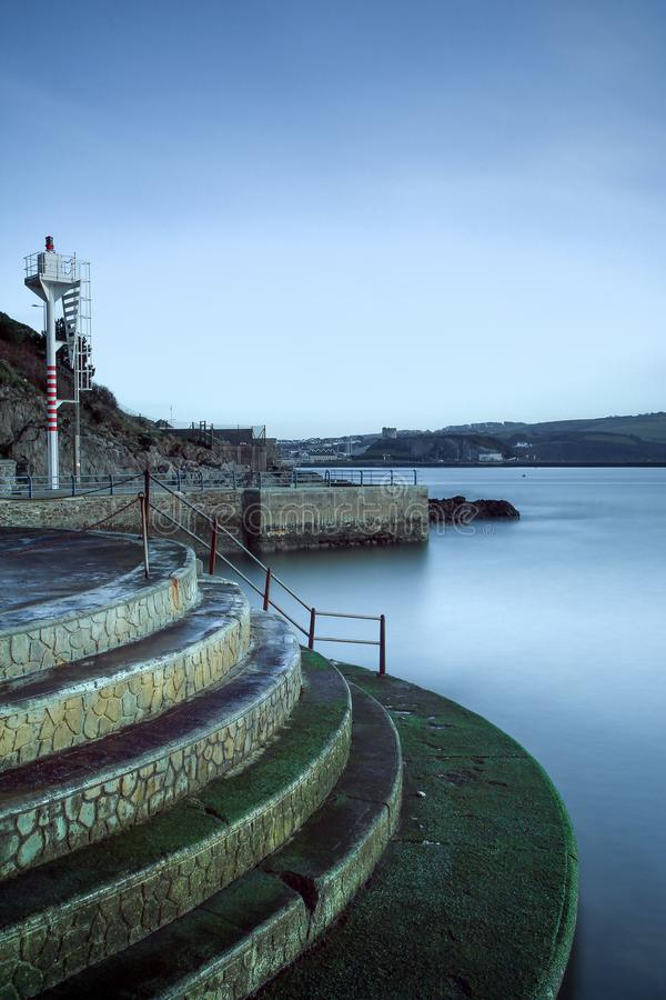 Waterfront Steps on Plymouth Sound. Slow Exposure Photograph. With cool blue tones royalty free stock photography