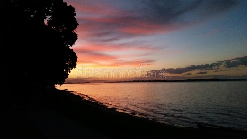 A waterfront sunset royalty free stock photos