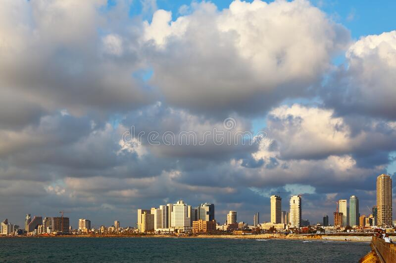 The waterfront in Tel Aviv. Magnificent panorama of the waterfront in Tel Aviv. Sunset on a windy and cloudy day in May royalty free stock image