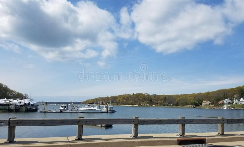 Waterfront view beautiful blue sku. Good time on warm restaurant stock photography
