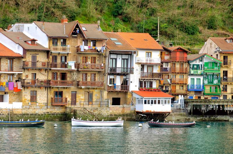 Waterfront view of Pasai Donibane, Spain. View of the fishing village along with its waterfront and boats in Pasai Donibane, Spain royalty free stock images