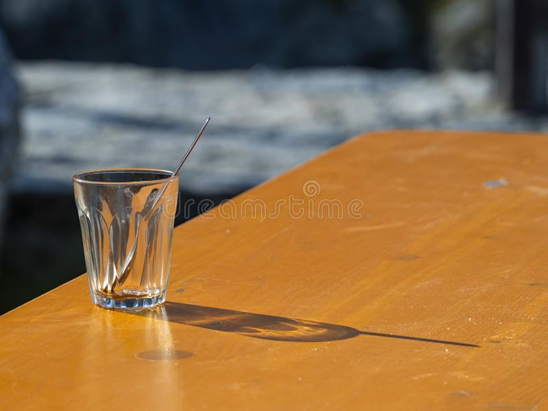 Waterglass on a table stock photo