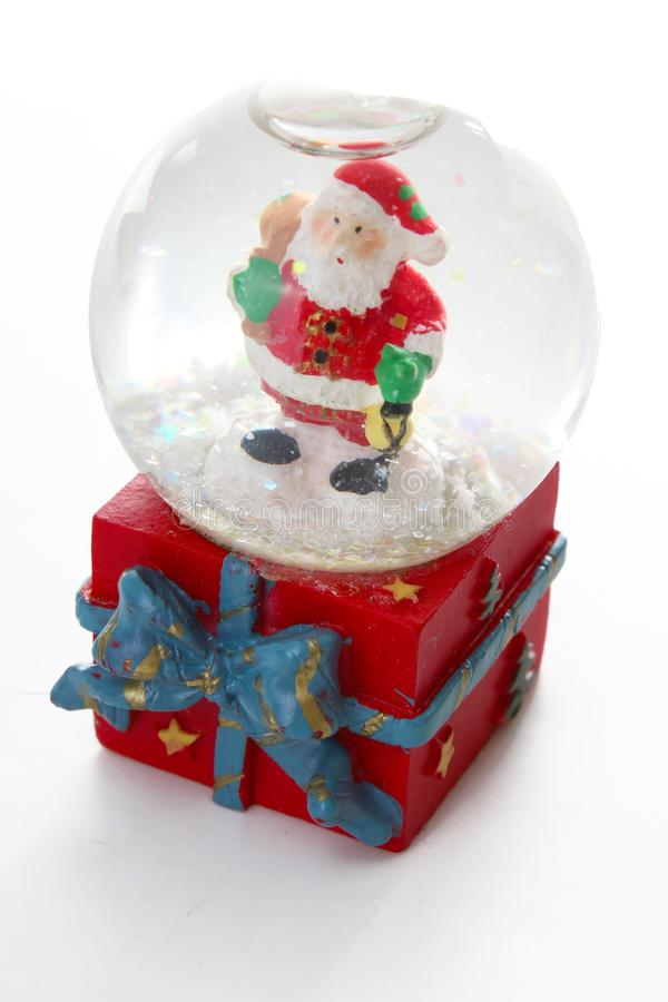 Waterglobe. Christmas waterglobe with Santa Claus. Christmas decoration glass ball water ball globe with snow and Santa. Claus. Christmas decoration on white stock images