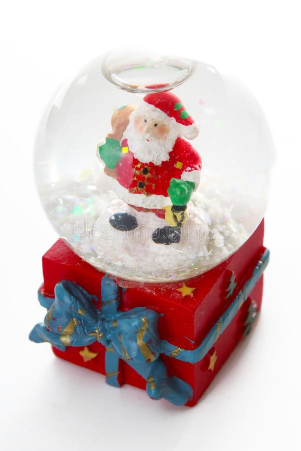 Waterglobe. Christmas waterglobe with Santa Claus. Christmas decoration glass ball water ball globe with snow and Santa. Claus. Christmas decoration on white stock photography