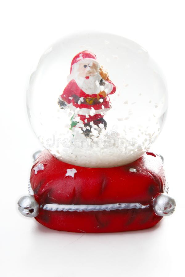 Waterglobe. Christmas waterglobe with Santa Claus. Christmas decoration glass ball water ball globe with snow and Santa. Claus. Christmas decoration on white royalty free stock image