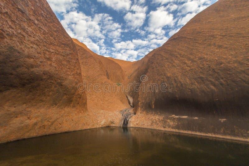 Waterhole Uluru стоковое фото