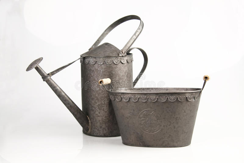 Watering can & basket royalty free stock photos