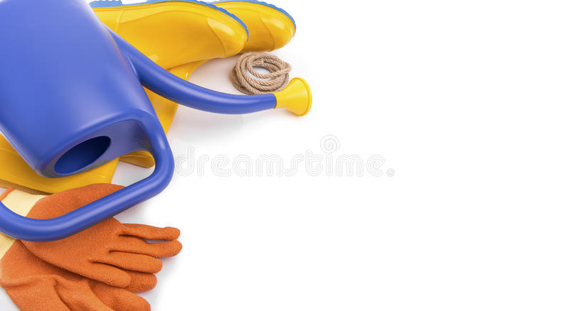 Watering can, rubber boots and working gloves. Watering can, rubber boots and working gloves on a white background royalty free stock photography