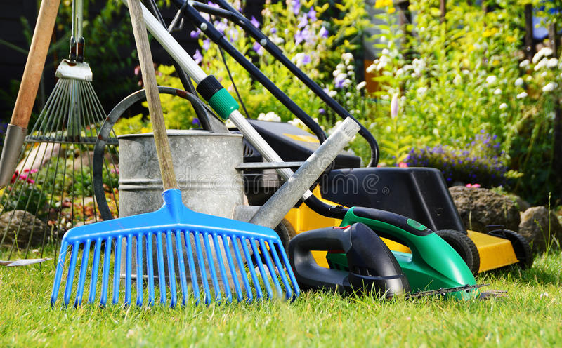 Watering can and tools in the garden stock photos
