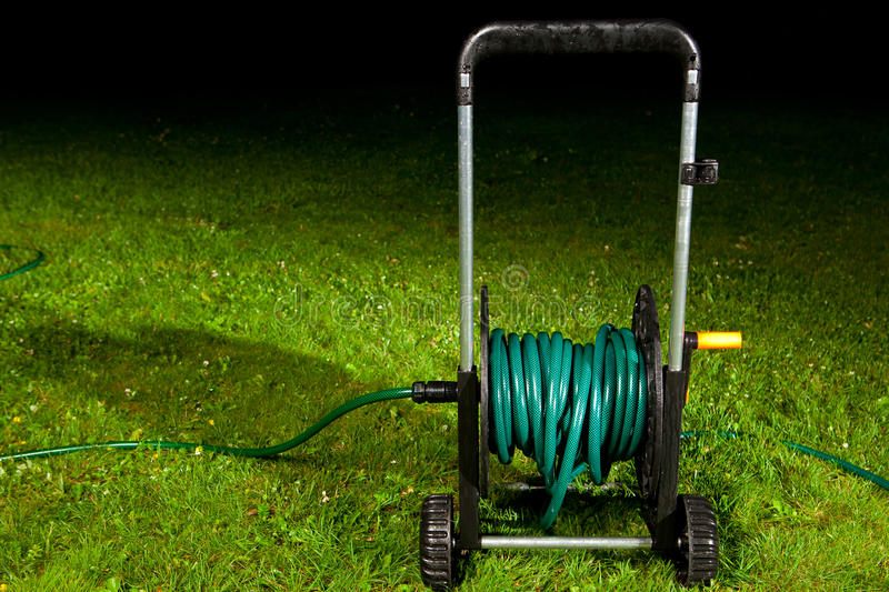 Download Watering Garden Hose Stock Photography - Image: 19558572