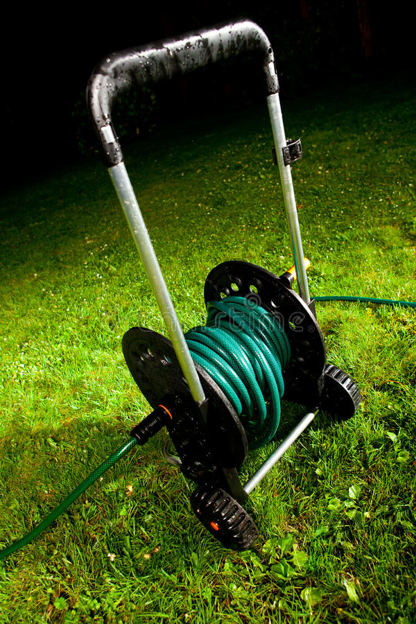 Watering garden hose. On the spool stock photography