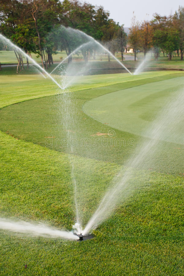 Free Watering In Golf Course Royalty Free Stock Image - 23880356