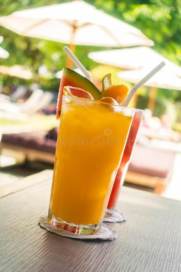 Waterlemon and orange juice in drinking glass. On table - Healthy food style stock photos