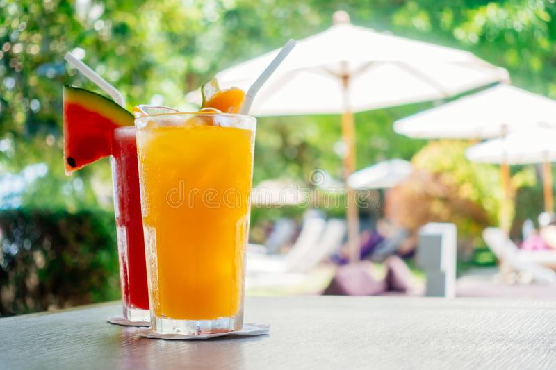Waterlemon and orange juice in drinking glass royalty free stock photography