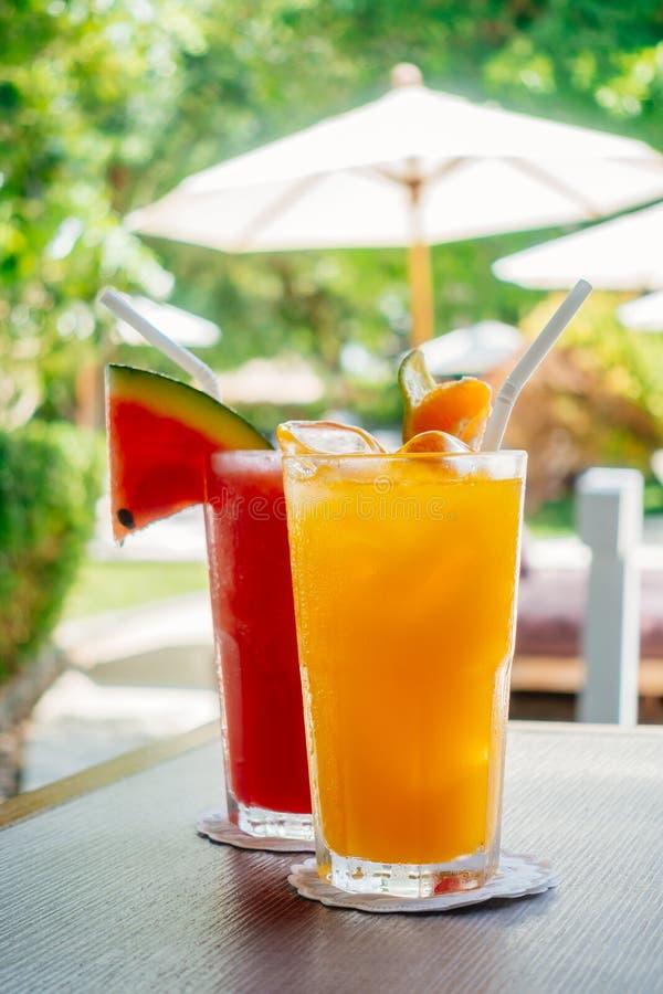 Waterlemon and orange juice in drinking glass stock photo