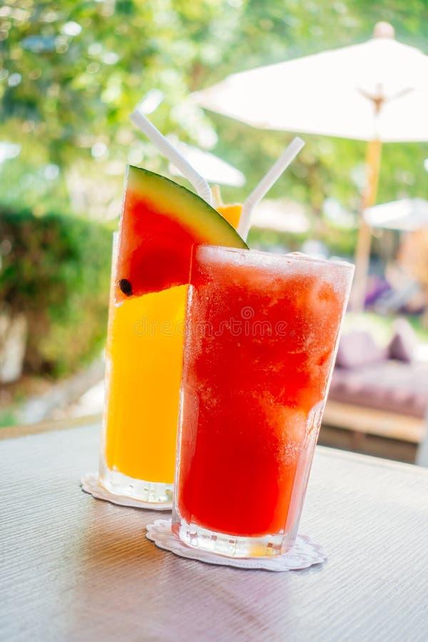 Waterlemon and orange juice in drinking glass stock photos