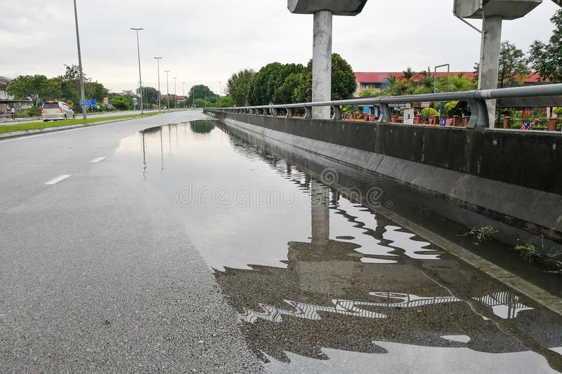 Waterlogged on road due to clogged drainage system stock images