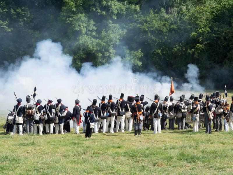 Waterloo, Belgium - June 18 2017: Scenes from the reenactment of. Waterloo, Belgium - June 18 2017: Allied forces fire their muskets during the re-enactment of stock image