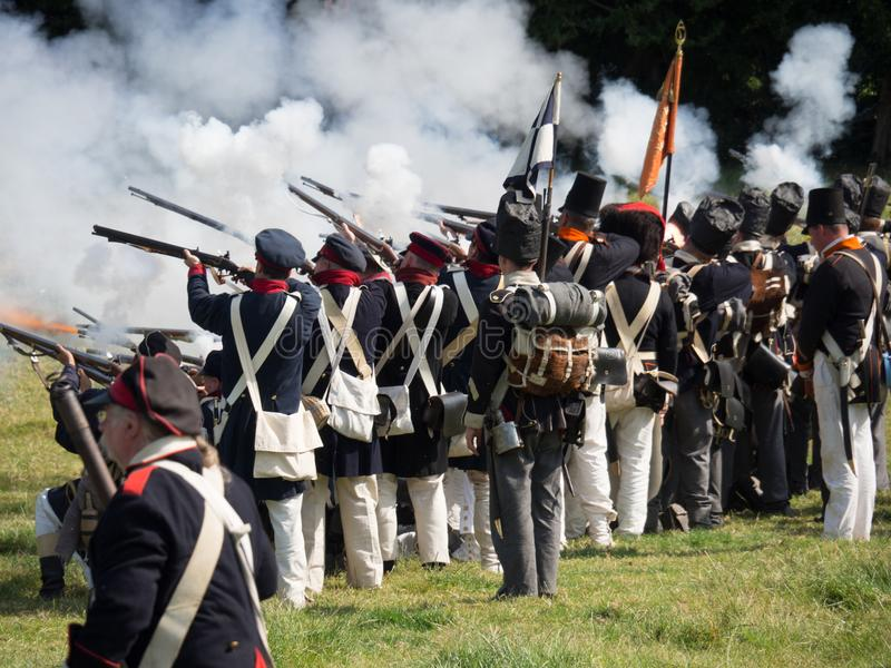 Waterloo, Belgium - June 18 2017: Scenes from the reenactment of. Waterloo, Belgium - June 18 2017: Allied forces fire their muskets during the re-enactment of royalty free stock photo