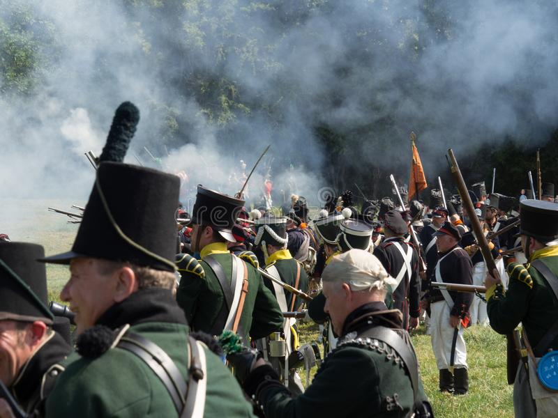 Waterloo, Belgium - June 18 2017: Scenes from the reenactment of. Waterloo, Belgium - June 18 2017: Allied forces fire their muskets during the re-enactment of stock images