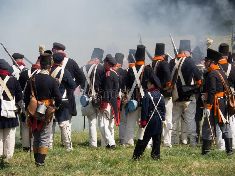 Waterloo, Belgium - June 18 2017: Scenes from the reenactment of. Waterloo, Belgium - June 18 2017: Allied forces reloading their muskets during the re-enactment stock images
