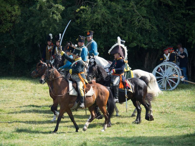Waterloo, Belgium - June 18 2017: Scenes from the reenactment of. Waterloo, Belgium - June 18 2017: A cavalry charge during the re-enactment of the battle at stock images