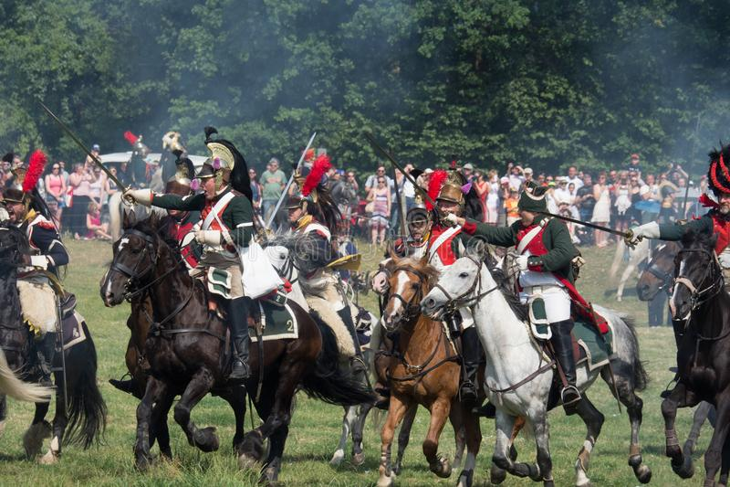 Waterloo, Belgium - June 18 2017: Scenes from the reenactment of. Waterloo, Belgium - June 18 2017: A cavalry charge during the re-enactment of the battle at stock photography
