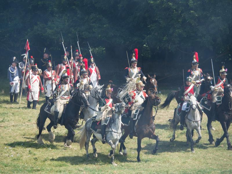 Waterloo, Belgium - June 18 2017: Scenes from the reenactment of. Waterloo, Belgium - June 18 2017: A cavalry charge during the re-enactment of the battle at stock photos
