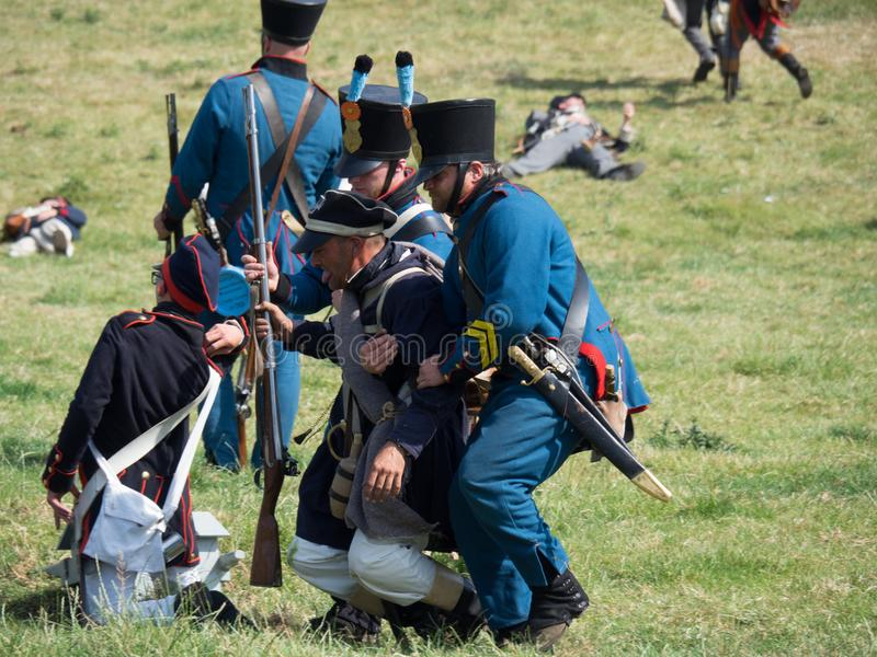 Waterloo, Belgium - June 18 2017: Scenes from the reenactment of. Waterloo, Belgium - June 18 2017: Medics help a wounded soldier at the re-enactment of the royalty free stock photo