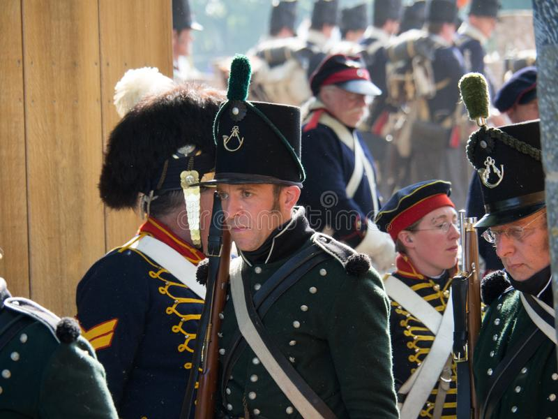 Waterloo, Belgium - June 18 2017: Scenes from the reenactment of. Waterloo, Belgium - June 18 2017: Several figurants dressed in 19the century military equipment royalty free stock photos