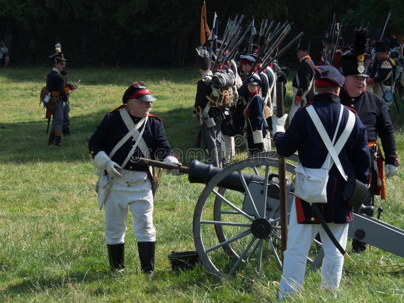 Waterloo, Belgium - June 18 2017: Scenes from the reenactment of. Waterloo, Belgium - June 18 2017: Soldiers reload and fire a cannon during the re-enactment of stock photo