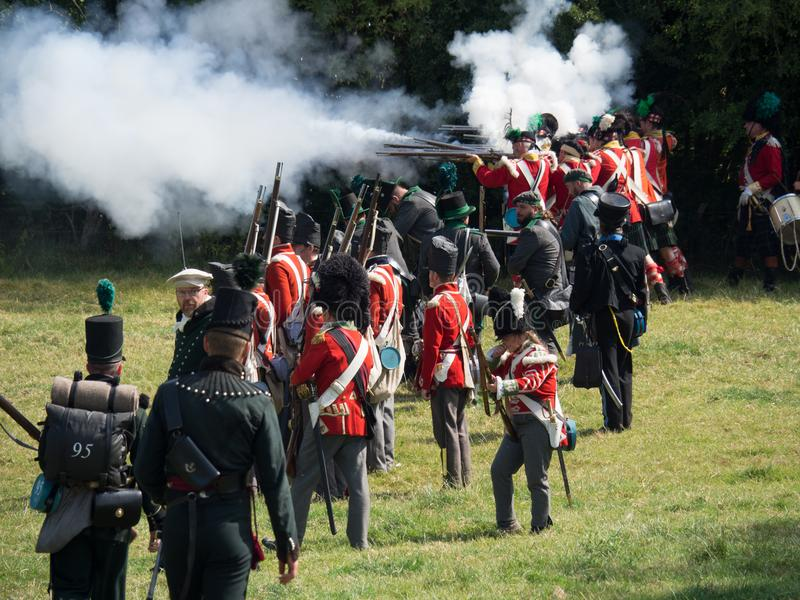 Waterloo, Belgium - June 18 2017: Scenes from the reenactment of. Waterloo, Belgium - June 18 2017: Allied forces fire their muskets during the re-enactment of stock photos