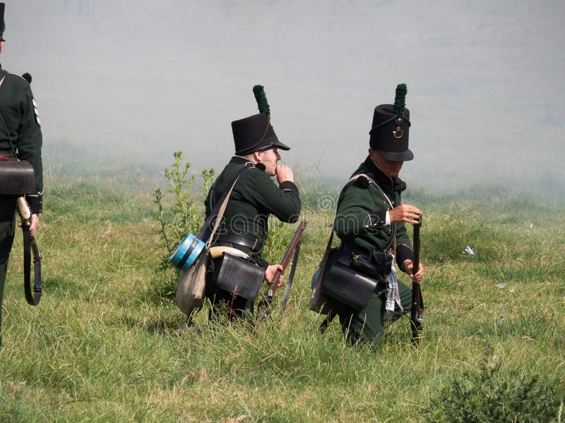 Waterloo, Belgium - June 18 2017: Scenes from the reenactment of. Waterloo, Belgium - June 18 2017: Allied forces reloading their muskets during the re-enactment royalty free stock photography