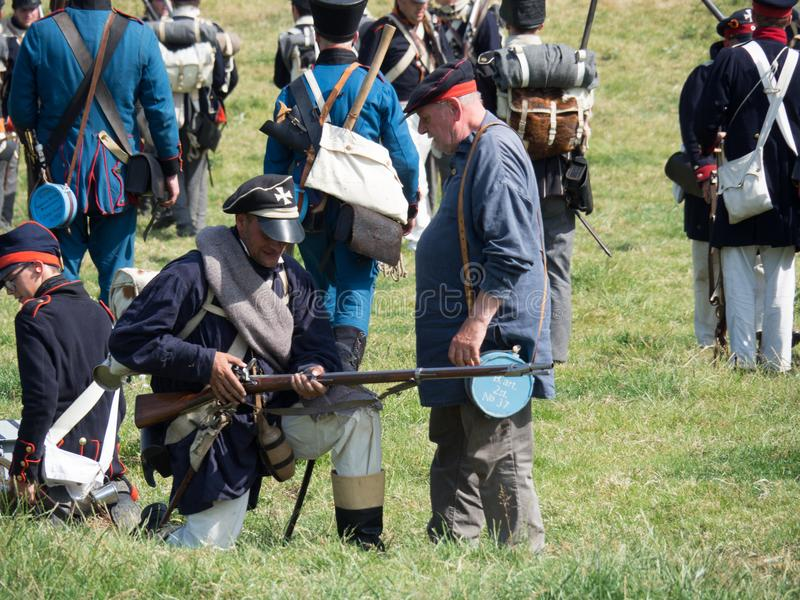 Waterloo, Belgium - June 18 2017: Scenes from the reenactment of. Waterloo, Belgium - June 18 2017: Allied forces reloading their muskets during the re-enactment stock image