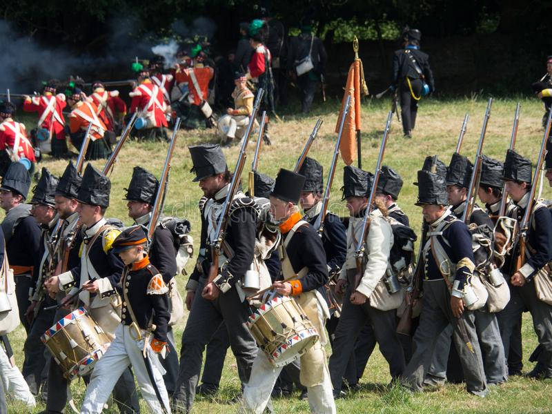 Waterloo, Belgium - June 18 2017: Scenes from the reenactment of. Waterloo, Belgium - June 18 2017: Dutch troops advancing towards the French during the re stock image