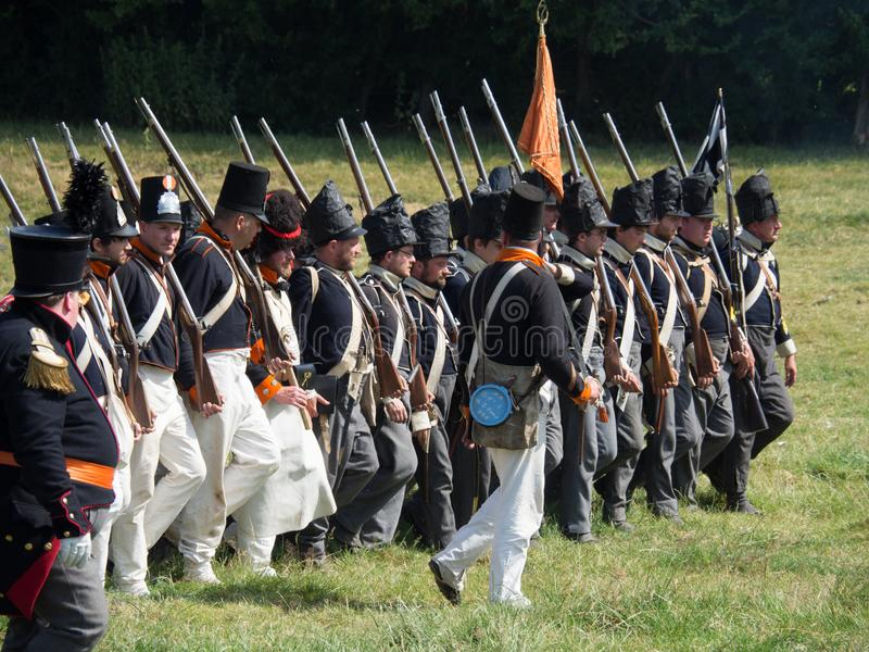 Waterloo, Belgium - June 18 2017: Scenes from the reenactment of. Waterloo, Belgium - June 18 2017: Dutch troops advancing towards the French during the re stock images