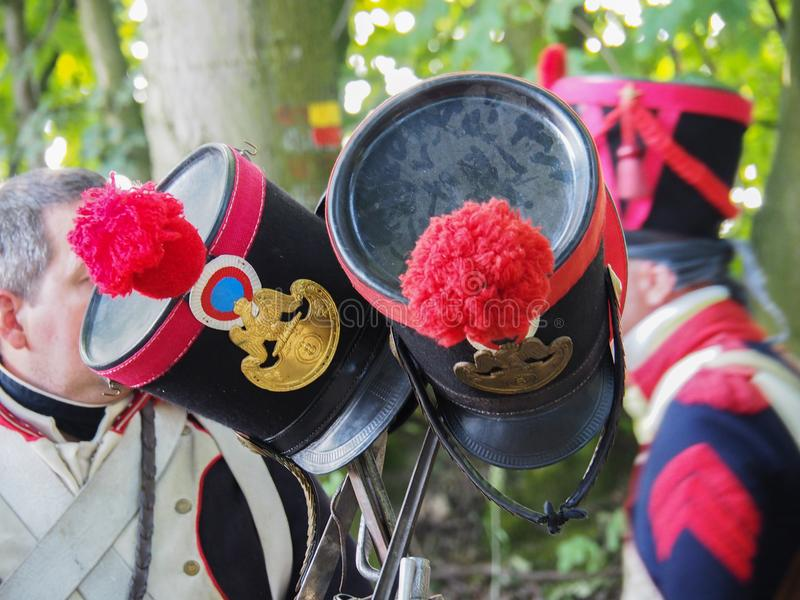 Waterloo, Belgium - June 18 2017: Scenes from the reenactment of. Waterloo, Belgium - June 18 2017: An image of two French hats placed on a musket during the re stock photography