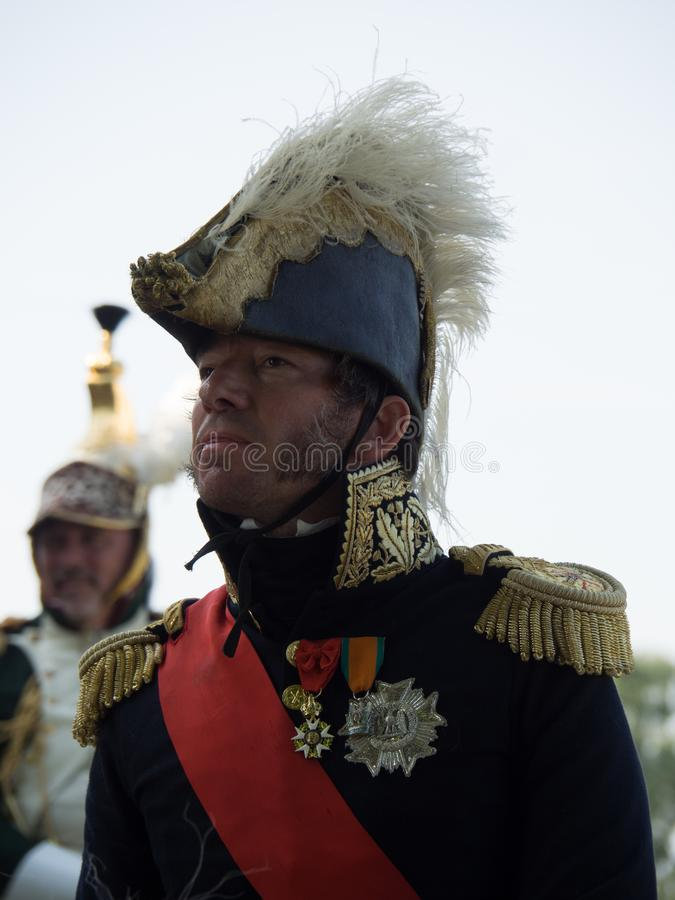 Waterloo, Belgium - June 18 2017: Scenes from the reenactment of. Waterloo, Belgium - June 18 2017: A rider dressed in a historic uniform during the re-enactment royalty free stock photos