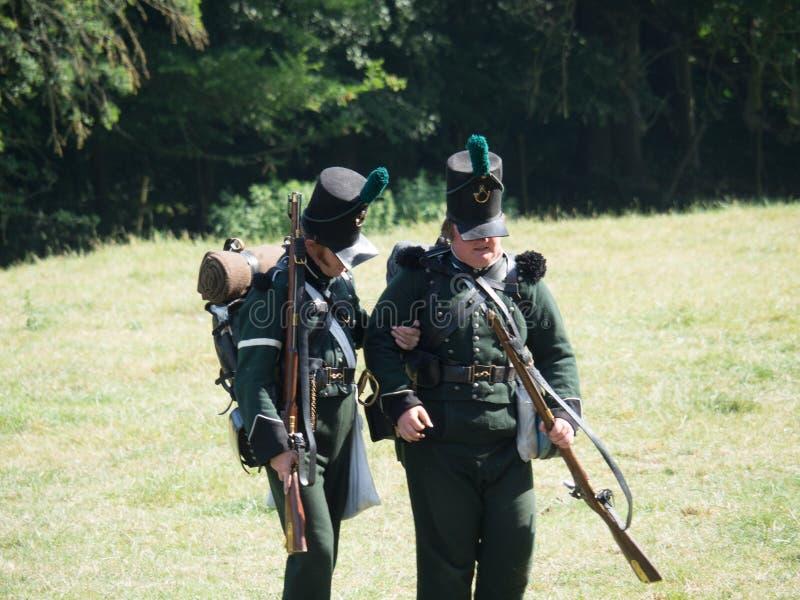 Waterloo, Belgium - June 18 2017: Scenes from the reenactment of. Waterloo, Belgium - June 18 2017: Several figurants dressed in 19the century military equipment stock image